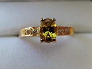 Oval cut yellow sapphire set into a gold ring
